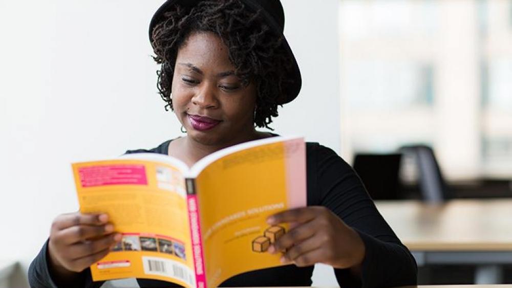 Girl reading financial book